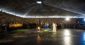 Pope Francis lays a wreath at the Hall of Remembrance at the Yad Vashem Holocaust memorial in Jerusalem. Photograph: AP/L'Osservatore Romano