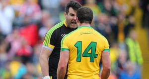 Donegal goalkeeper Paul Durcan celebrates with his  captain Michael Murphy after the final whistle at Celtic Park.