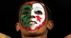 An Algerian supporter at the semi-final match of the African Cupin  2010. Photograph:  Gianluigi Guercia/AFP/Getty Images