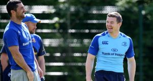 Rob Kearney and Brian O'Driscoll share a lighter moment during a Leinster squad training a session at UCD ahead of the Pro 12 final on Saturday. Photograph: Inpho