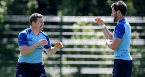 Brian O'Driscoll and Sam Windsor share a laugh at Leinster training in UCD. Photograph: Dan Sheridan/Inpho.
