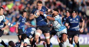Leinster's Jamie Heaslip hands off the challenge of Glasgow's Niko Matawalu in last year's semi-final victory at the RDS.