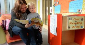 Sylwia Schonfeld and her son, Jakub (4), from Fairview, Dublin, reading as part of Chatter Matters at the Larkin Childcare Facility, Ballybough Preschool, Ballybough, Dublin. Photograph: Dara Mac Dónaill
