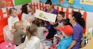 Sinéad Mulhall reading, with Marie Byrne (right), to children as part of Chatter Matters at the Larkin Childcare Facility, Ballybough Preschool, Ballybough, Dublin. Photograph: Dara Mac Dónaill