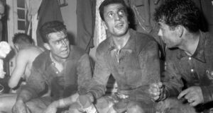 Mustapha Zitouni (centre) celebrates alongside his then French teammates Yvon Douis and Just Fontaine after an international at the Parc des Princes in March, 1958. A matter of weeks later, Zitouni had 'defected' to his native Algeria. Photograph: Presse Sports/freshfocus