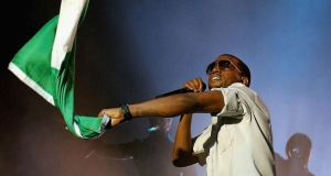 Rap party: Kanye West performs at the Point Theatre in 2006 in Dublin. Photograph:  ShowBizIreland/Getty Images