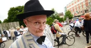 Literary authenticity: Paul Kennedy dressed as James Joyce  with over 150 Participants in the 20th annual   Bloomsday  bike rally. Photograph: Alan Betson