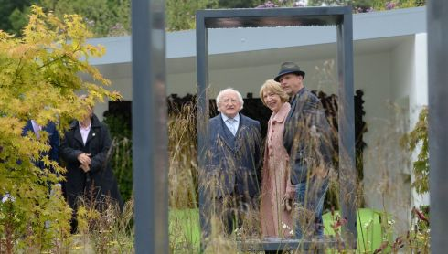 President Michael D Higgins and his wife Sabina with designer Kevin Dennis from Raheny Dublin. Mr Dennis was a gold medal winner for his garden 'Renault ZOE: City Life Garden'. Photograph: Dara Mac Donaill / The Irish Times