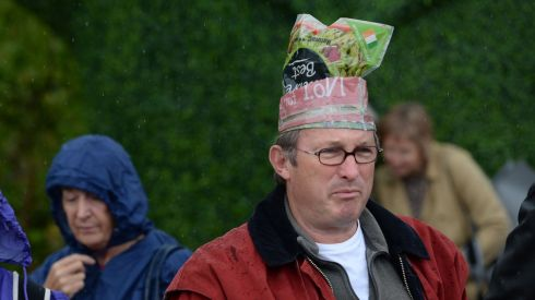 Patrick Gardner from Kilkenny keeps his head dry at the opening day of the Bloom Garden Festival.  Photograph: Dara Mac Donaill / The Irish Times