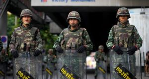 Soldiers block a street to prevent a protesters' rally at the Victory Monument in Bangkok. Photograph: Diego Azubel/EPA