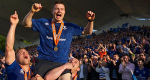 Brian O'Driscoll of Leinster, in the last match of his career, is carried by Ian Madigan and Cian Healy after winning the Pro 12 trophy with victory over Glasgow  at the RDS.  Photograph:  Patrick Bolger/Getty Images