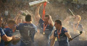 Leinster players celebrate winning the RaboDirect PRO12 Final at the RDS. Photograph:  Niall Carson/PA Wire