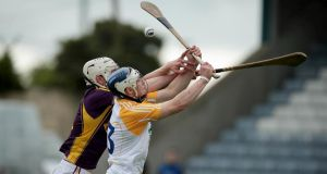 Antrim's Conor Johnson battles for possession with Liam Ryan of Wexford in Portlaoise. Photograph: Morgan Treacy/Inpho