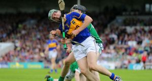 Tipperary's Cathal Barrett feels the weight of a Limerick challenge during the Munster championship clash in Thurles. Photo: Cathal Noonan/Inpho