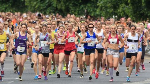 The opening group after the Mini Marathon started - plenty of determination on show. Photograph: Niall Carson/PA Wire