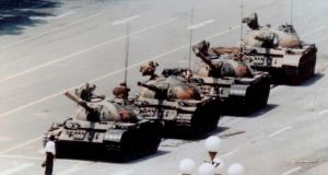 """Tank Man"" who placed his shopping bags down to face down the tanks.   in Beijing's Tiananmen Square on June 5th, 1989, at the height of the pro-democracy protests. Photograph: Jeff Widener/AP"
