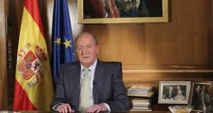 Spain's King Juan Carlos makes a televised speech yesterday  in the Zarzuela Palace in Madrid announcing his abdication. Photograph: AP