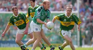 Limerick's John Quane takes Kerry on Munster football final replay Kin 2004. Photograph: Inpho.