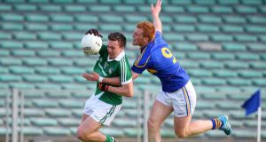 George Hannigan of Tipperary tackles Limerick's Cian Sheehan during the Munster senior championship quarter-final at Gaelic Grounds. Photograph: Inpho.