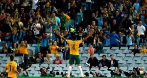 Australia's Tim Cahill holds the hopes of a nation on his shoulders.  Photograph: Jason Reed / Reuters