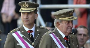 King Juan Carlos of Spain and his son Felipe arrive for a military ceremony of the San Hermenegildo order held at the monastery of San Lorenzo de El Escorial on the outskirts of Madrid yesterday. Photograph: EPA/Ballesteros
