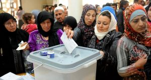 Syrians cast their votes in Syria's presidential elections at a polling station in Jdaydet Yabous yesterday. Photograph: EPA/Sana
