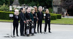 Oxfam activists wear masks depicting leaders of the G7 members: (L-R) French president Francois Hollande; Italian prime minister Matteo Renzi; British prime minister David Cameron; German chancellor Angela Merkel; US president Barack Obama; Canadian prime minister Stephen Harper and Japanese prime minister Shinzo Abe during a protest outside the European Council in Brussels. Photograph: Yves Herman/Reuters.