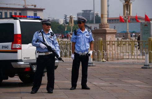 Armed police stand guard at Tiananmen Square in Beijing. Photograph: Petar Kujundzic /Reuters