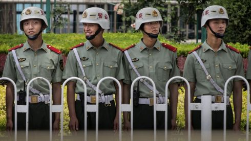 Chinese Paramilitary police stand guard near Tiananmen Square in Beijing, China on the anniversary of  the crack down on pro-democracy protesters. Photograph: Kevin Frayer/Getty Images