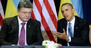 Ukrainian president-elect Petro Poroshenko (L) and US president Barack Obama (R) attend a meeting in Warsaw, Poland today. Kiev  claims that 300 Russian sepratists were killed in the last 24 hours. Photograph: Jacek Turczyk/EPA.
