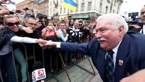 Former President of Poland, Solidarity Movement leader and Nobel Peace Prize laureate Lech Walesa (R) greets the crowds as he attends for the 'Freedom Day' celebrations at the Castle Square in Warsaw. Photograph: Tomasz Gzell Poland Out/EPA .