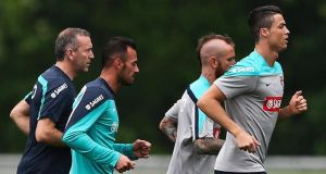Portugal's Cristiano Ronaldo (right) with physiotherapist Antonio Gaspar (left) and teamates Beto ( second left) and Raul Meireles (second right) during a training session at the New York Jets training centre in Newark. Photograph: Jose Sena Goulao / EPA
