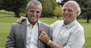 Golfer Paul McGinley and his father, Michael, who had blocked arteries and underwent a quadruple heart bypass.