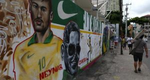 A mural showing Brazilian footballer Neymar and Angenor de Oliveira, known as Cartola, a Brazilian singer and composer (1908-1980) at the Terreirao do Samba (Samba Land), in Rio de Janeiro. Photograph: Marcelo Sayao/EPA