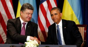 "President Barack Obama shaking hands with Ukraine's president-elect Petro Poroshenko during their meeting in Warsaw yesterday. The US leader told reporters the billionaire industrialist was a ""wise choice"" by Ukrainian voters and a clear signal against violence. Photograph: Reuters"