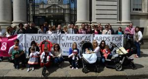 The campaign group Our Children's Health, which held a protest outside Government Buildings Dublin last month over removal of medical cards. Photograph: Dara Mac Dónaill