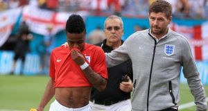England's Steven Gerrard (right) consoles teammate Raheem Sterling (left) after he was shown a red card against Ecuador  at the Sun Life Stadium in Miami, USA. Photograph:  Mike Egerton/PA Wire