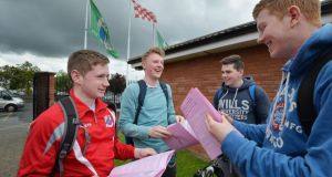 Leaving Certificate students Kevin Nangle, Liam Ashton, Mark Hodson and Lorcan Reilly at St Aidan's CBS, Collins Avenue, Whitehall peruse their Leaving Certificate English Paper 1.  Photograph: Alan Betson