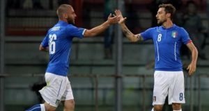 Claudio Marchisio (right) with his teammate Daniele De Rossi of Italy celebrates scoring against Luxembourg  in Perugia. Photograph:   Paolo Bruno/Getty Images