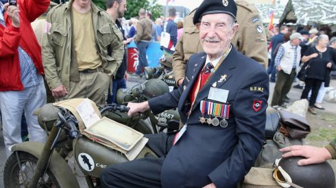 Henry McGill sits on a Matchless Motorbike during D-Day 70 Commemorations in Ranville, France. Henry McGill was a dispatch rider on the bikes with the 5th Guards Armoured Division.  Friday 6th June is the 70th anniversary of the D-Day landings which saw 156,000 troops from the allied countries join forces to launch an audacious attack on the beaches of Normandy, these assaults are credited with the eventual defeat of Nazi Germany. Photograph Chris Jackson/Getty Images