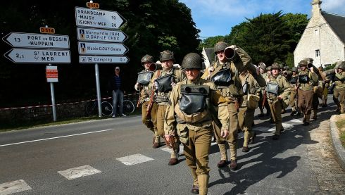 Military enthusiasts march outside their camp just south of Omaha Beach on the day before the 70th anniversary of D-Day in Vierville, France. Photograph Win McNamee/Getty Images