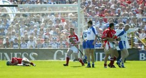 In the Munster Hurling Final of June 2004 Waterford's John Mullane is restrained by Cork's Seán Óg Ó'hAilpín after striking Brian Murphy. Photograph:Patrick Bolger/Inpho