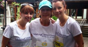 Anna and Alison Boland with their mother, Helen Boland, at the Flora Mini Marathon on June 2nd, 2014