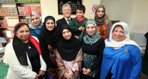 A photograph of First Minister Peter Robinson with members of the Muslim community during his visit to the Belfast Islamic Centre in Wellington Park, south Belfast earlier this week,  where he made a public apology for any offence caused to Muslims by his defence of  controversial pastor James McConnell. Photograph: Kelvin Boyes/Press Eye /PA Wire.