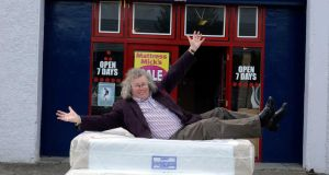 Soft landing: Mattress Mick shows off his wares. Photograph: Dave Meehan