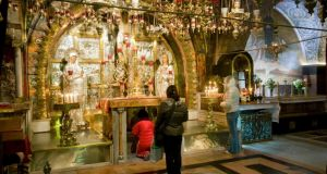 The Greek altar   in the Church of the Holy Sepulchre, Jerusalem.  Photograph: Danita Delimont/Gallo Images