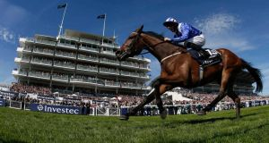 Taghrooda, ridden by Paul Hanagan, wins the Oaks during Ladies Day at the Epsom Derby Festival. Photograph: Stefan Wermuth/Reuters