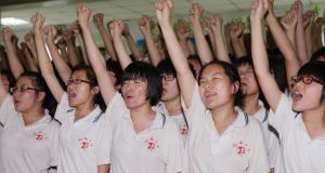 Students cheer during a morale-building event ahead of the upcoming national college entrance examination at Hengshui No 2 High School in  Hebei province. Photograph: Reuters