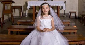 'First communion: your dad will surely still love you if you allow his grandchild to defer any induction into organised religion until he or she is old enough to vote.' Photograph: Getty Images