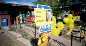 Signs of support with images of Bowe Bergdahl outside Zaney's coffee shop in the US army sergeant's home town,  Hailey, Idaho. Photograph: Reuters/Patrick Sweeney